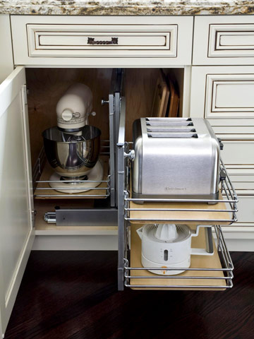 To make your kitchen look neat and clean it is good to keep small appliances out of sight but in order so that you can easily reach them.