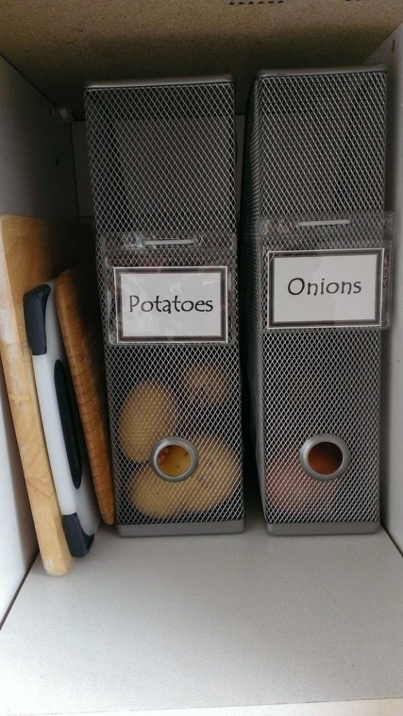 Use-magazine-holders-to-keep-your-onions-and-potatoes