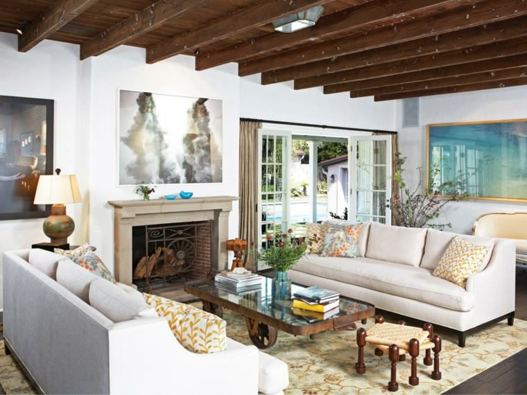Living Room Decorated With Wooden Ceiling And Stone Fireplace